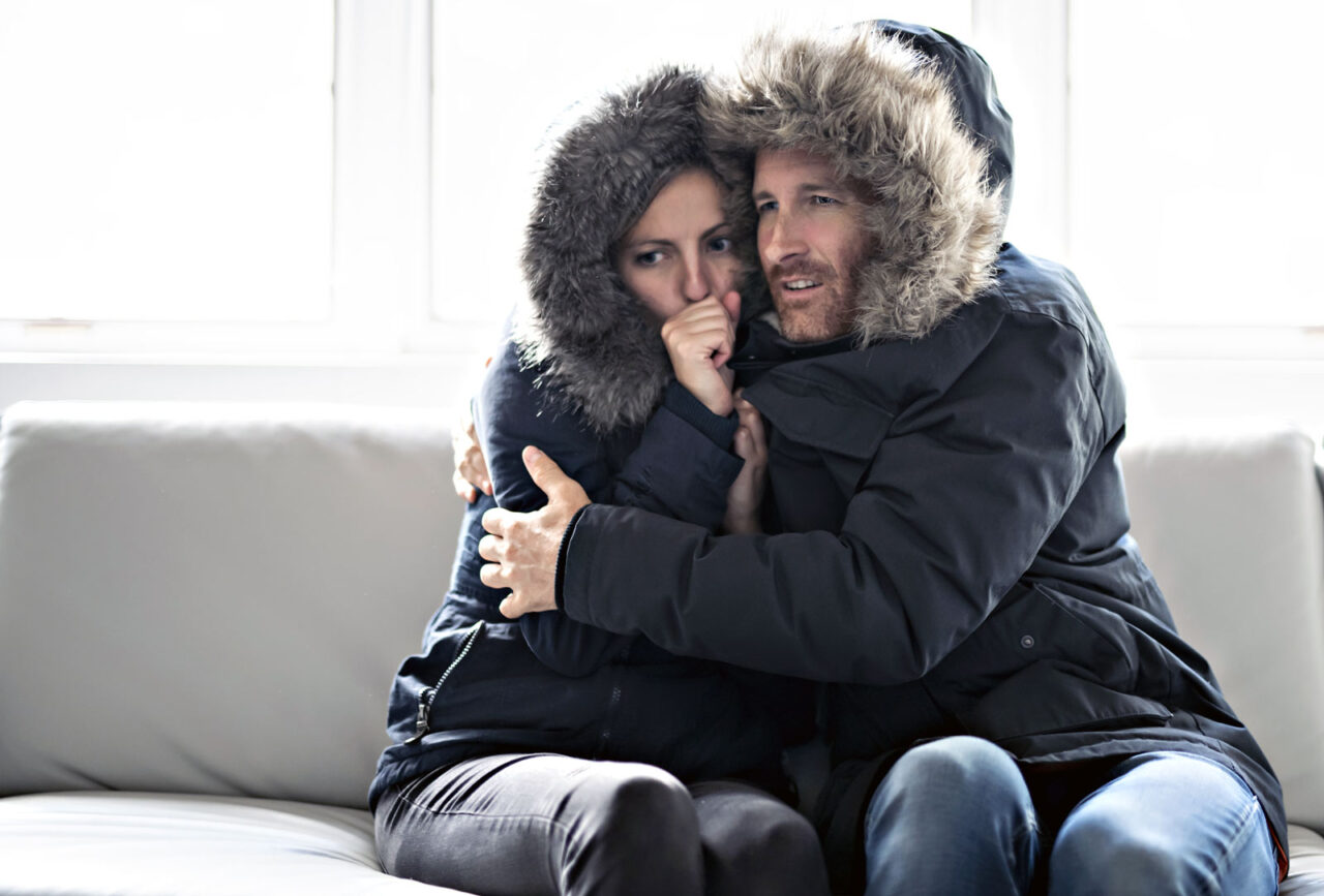 https://southendhvac.com/wp-content/uploads/2020/11/couple-suffering-cold-air-blowing-out-furnace-1280x867.jpg
