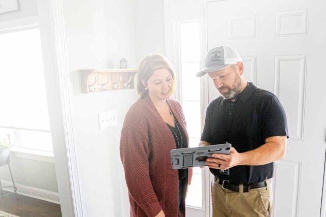 An AC repairman helping a customer in Charlotte north Carolina